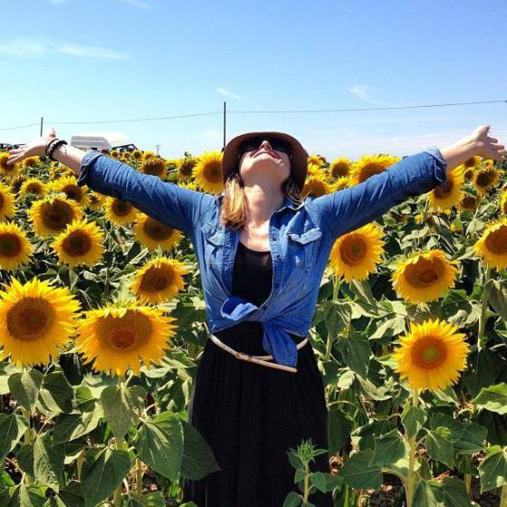 Letting Go in a field of sunflowers in Tuscany.